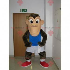 Braunes Schimpansenaffenmaskottchen in der Sportbekleidung -