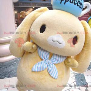 Mascot little yellow rabbit with a teapot on his head -