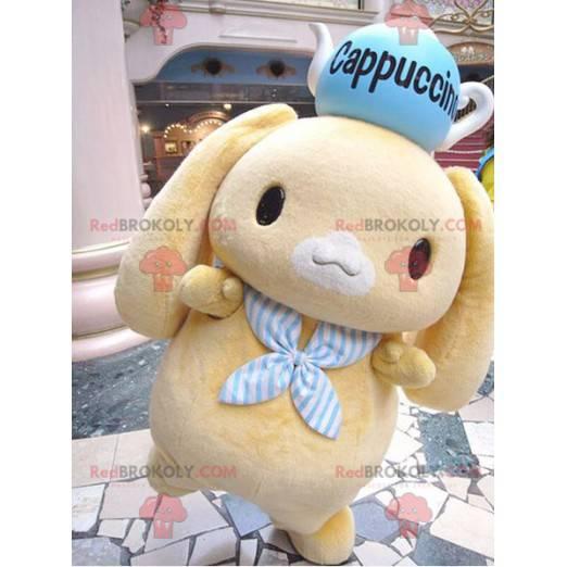 Maskottchen kleines gelbes Kaninchen mit einer Teekanne auf dem