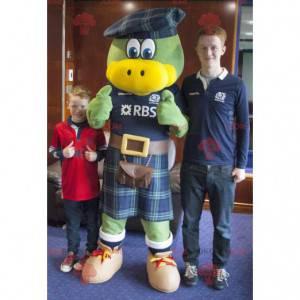 Green and yellow bird mascot dressed in Scottish -
