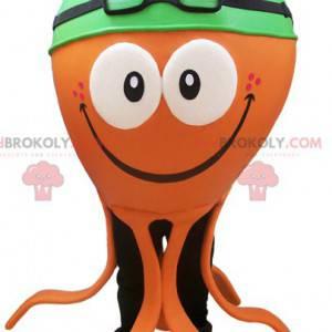Oranžový maskot chobotnice se zelenou plaveckou čepicí -