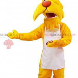 Mascota de perro bigote amarillo vestida con un delantal blanco