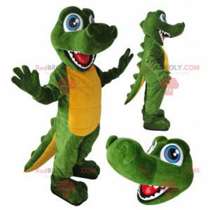 Green and yellow crocodile mascot with blue eyes -