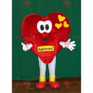 Gigantyczna czerwona i żółta maskotka serca. Romantyczna