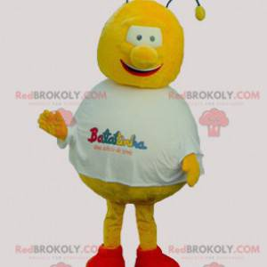 Rundes und lustiges gelbes und rotes Bienenmaskottchen -