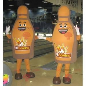 2 braune und lächelnde Kegelmaskottchen - Redbrokoly.com