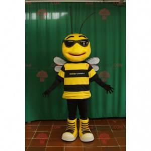 Schwarzes und gelbes Bienenmaskottchen mit Sonnenbrille -