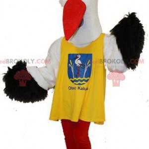 Black and white stork mascot with a yellow bib - Redbrokoly.com