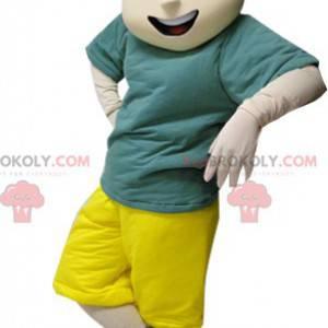 Maskotka brązowy chłopiec w zielono-żółtym stroju -