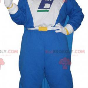 Smiling snowman mascot with a jumpsuit and a cape -