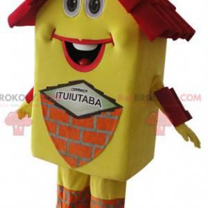 Velmi usměvavý žlutý a červený maskot domu - Redbrokoly.com