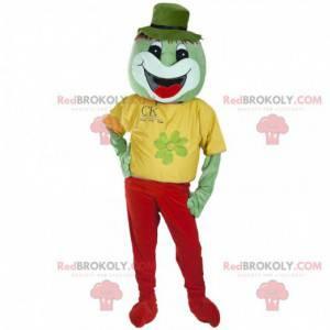 Smilende grønn skapning maskot kledd i rødt og gult -