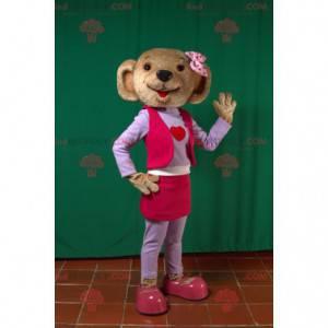 Maskotka niedźwiedź brunatny w różowo-fioletowym stroju -