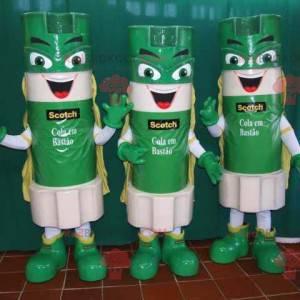 3 Maskottchen mit grünen und weißen Klebestiften -