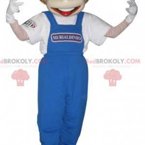 Jungenmaskottchen in blauen Overalls gekleidet - Redbrokoly.com