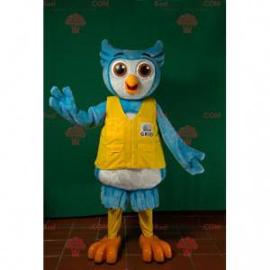 Blue and white owl mascot with a yellow vest - Redbrokoly.com