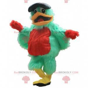 Grünes und rotes Vogelmaskottchen mit einer Baskenmütze -
