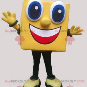 Quadratisches und lächelndes gelbes Schneemannmaskottchen -