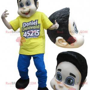 Brun tenåringsgutt maskot kledd i gult og blått - Redbrokoly.com