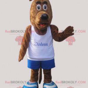 Braunes Hundemaskottchen gekleidet in Sportbekleidung -
