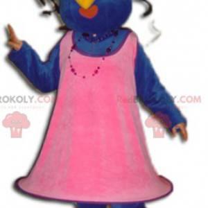 Blaues und gelbes Vogelmaskottchen gekleidet in einem rosa