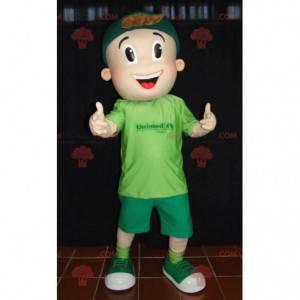 Mladý teenager chlapec maskot oblečený v zelené barvě -