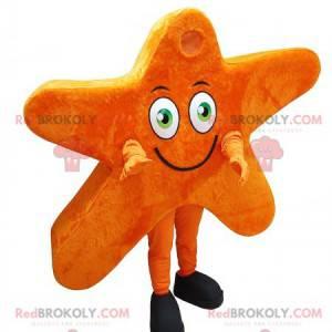 Gigantyczna i uśmiechnięta pomarańczowa maskotka gwiazdy -