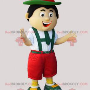 Tirolsk maskot i tradisjonell grønn rød og hvit kjole -