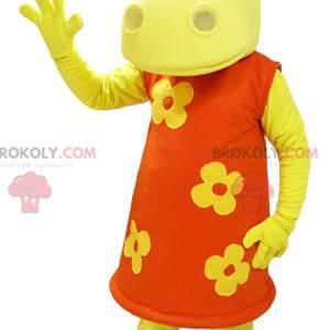 Geel nijlpaard mascotte gekleed in een oranje bloemenjurk -