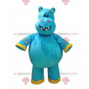 Mascote hipopótamo azul e amarelo muito divertido -