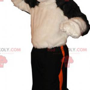 Měkký a chlupatý béžový a černý vlčí pes maskot - Redbrokoly.com