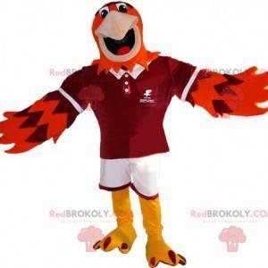 Oranžový a fialový maskot orla ve sportovním oblečení -