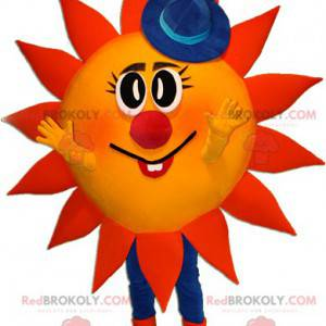 Červené a žluté sluneční maskot s modrým kloboukem -