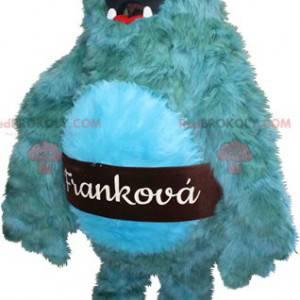 Haariges und lustiges blaues Monstermaskottchen.