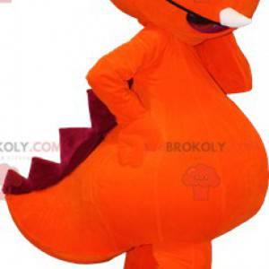 Riesiges orange und rotes Dinosauriermaskottchen -