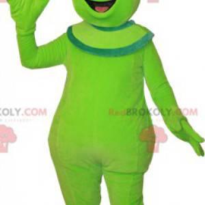 Roztomilý a usměvavý zelený mimozemský mimozemský maskot -