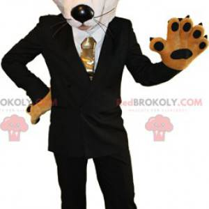 Maskot oranžové a bílé lišky oblečený v černém kostýmu -