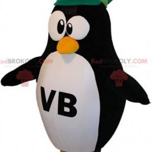Svart-hvit pingvin maskot med en politimannshatt -
