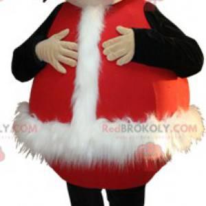 Lächelndes Jungenmaskottchen verkleidet als Weihnachtsmann -