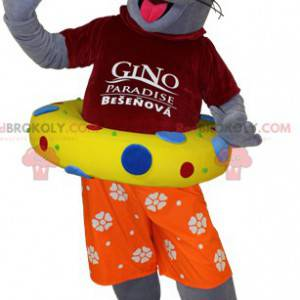 Gray otter sea lion mascot dressed as a vacationer -