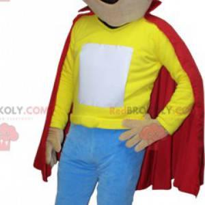 Braunes Jungenmaskottchen mit einem roten Umhang -
