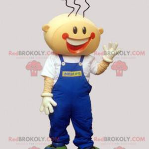 Lächelndes Jungenmaskottchen mit Overalls - Redbrokoly.com