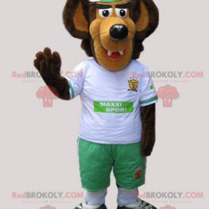 Brown and beige wolf mascot dressed in white and green -