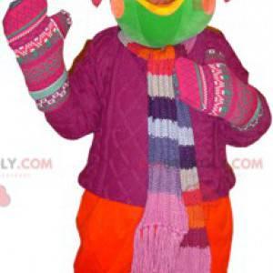 Green bird mascot dressed in winter clothes - Redbrokoly.com
