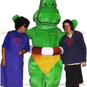 Zielony smok maskotka dinozaur z żółtymi majtkami -