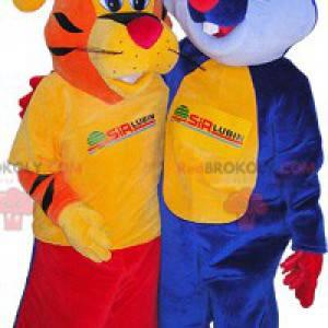 2 Maskottchen: ein orangefarbener Tiger und ein blaues