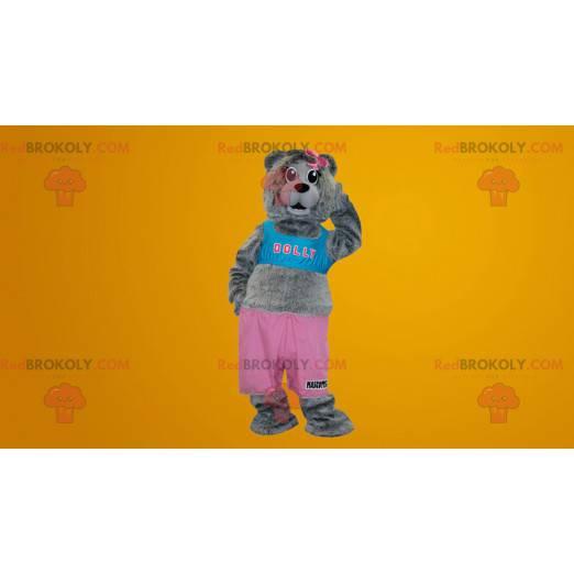 Graues Teddybärmaskottchen gekleidet in Rosa und Blau -