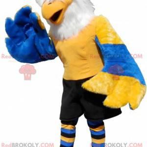 Maskot žlutá modrá a bílá orlice s černými kraťasy -