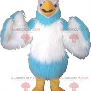 Weißes Himmelblau und Gelb des riesigen Vogelmaskottchens -