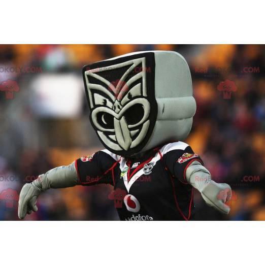Šedá a černá maorská socha maskot - Redbrokoly.com